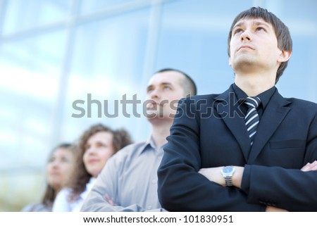 business team standing in a row at office and looking upwards - Successful business team - stock photo