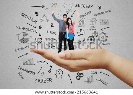 Business team standing on a palm celebrate success together - stock photo