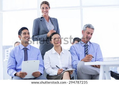 business team taking a note during a meeting in the office - stock photo