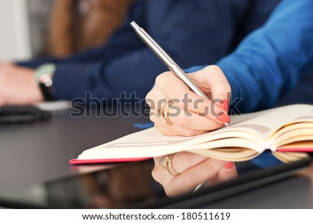 Business team taking notes on a meeting - stock photo