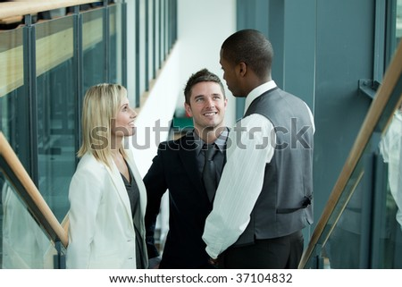 Business team talking about work in workplace - stock photo