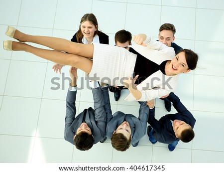 business team throwing his colleague. top view - stock photo
