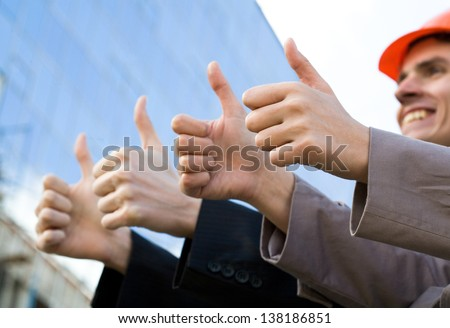 Business team thump up together showing sign ok - stock photo