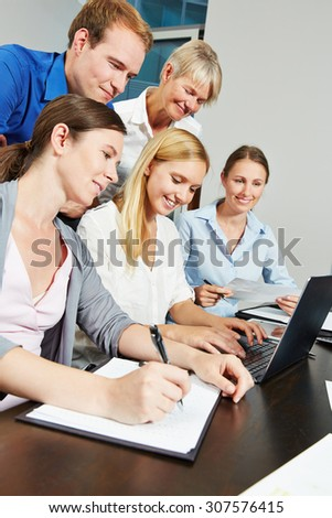 Business team using internet connection with laptop computer in the office - stock photo