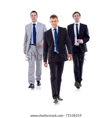 Business team walking - leadership and teamwork concepts using a group of businessmen isolated on white