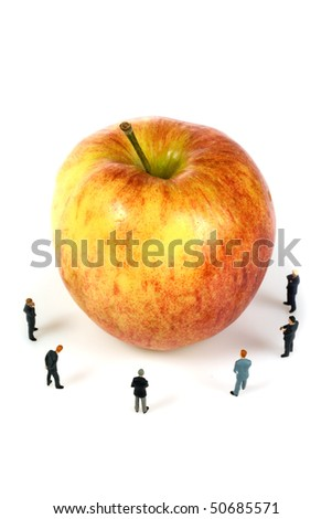 business team with a apple isolated over a white background - stock photo