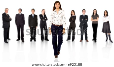business team with a businesswoman walking forward leading it - be different concept - isolated over a white background - stock photo