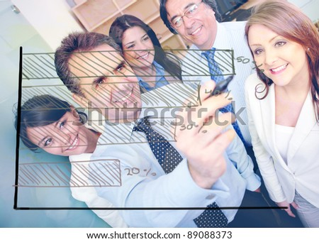 Business team with a graph showing the progress of a company - stock photo
