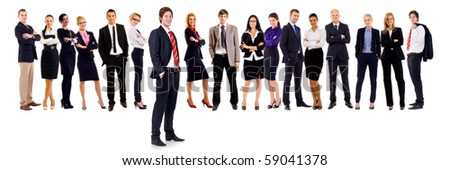 Business team with a male leader with hands in his pockets - stock photo