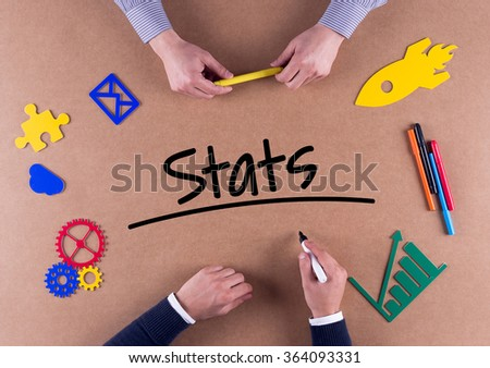 Business Team with a single word Stats - stock photo