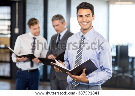 Business team with document and organizer in office - stock photo