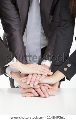 business team with hand together on the table for teamwork concept - stock photo