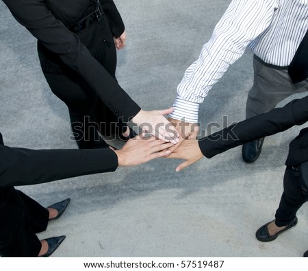 Business team with hands in a huddle