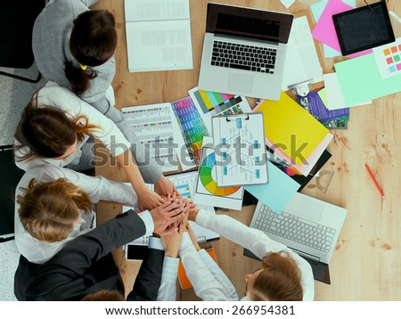 Business team with hands together - teamwork concepts . - stock photo