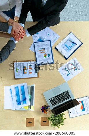 Business team with hands together - teamwork concepts - stock photo