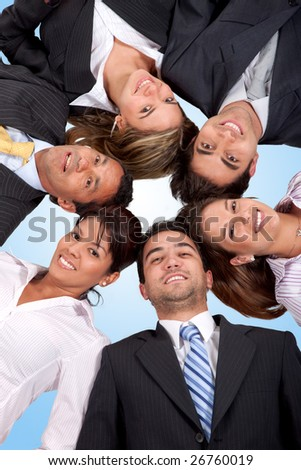 business team with heads together on the floor isolated