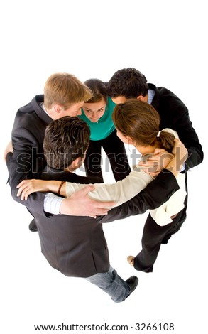 Business team with heads together to convey the concept of teamwork - isolated over a white background - stock photo