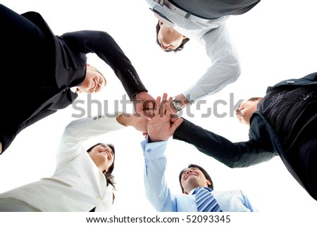 Business team with their hands together in the middle isolated over white - stock photo
