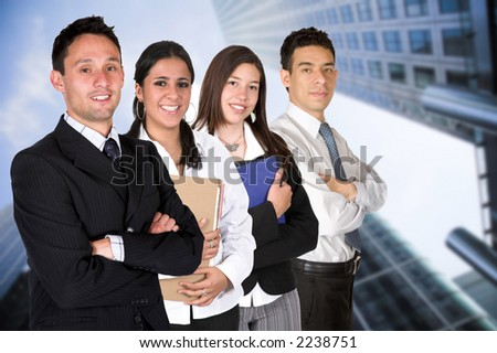 business team work in a business environment - all members of business team are smiling - stock photo
