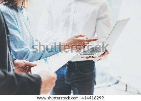 Business team work new ideas process. Photo professional crew working with startup project. Project managers meeting. Analyze business plans laptop. Blurred background, film effect. Horizontal - stock photo