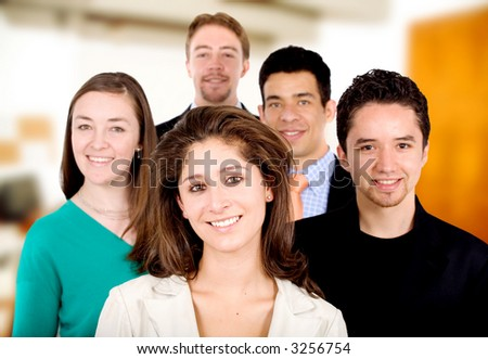business team work - portrait of a group of young businessmen and businesswomen in their office - stock photo