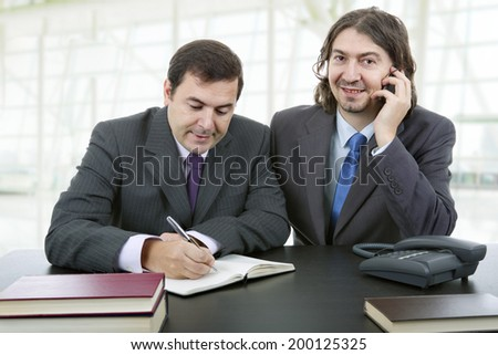 business team working at a desk at the office