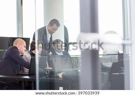 Business team working in corporate office. Working meeting with business people brainstorming. Business and entrepreneurship concept. - stock photo