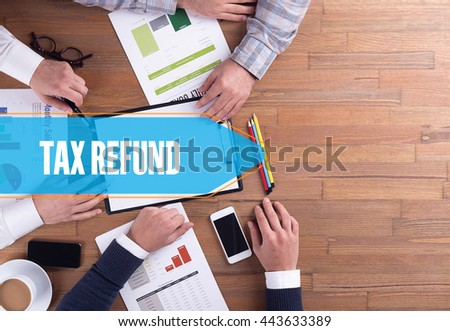 BUSINESS TEAM WORKING OFFICE TAX REFUND DESK CONCEPT - stock photo