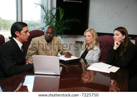 Business team working on a project at the office - stock photo