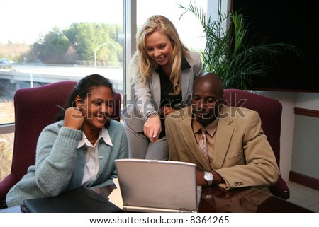 Business team working on a project for work - stock photo