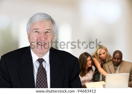 Business team working on a project in their office - stock photo
