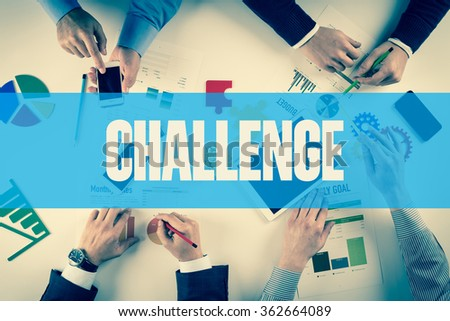 Business team working on desk with CHALLENGE word - stock photo