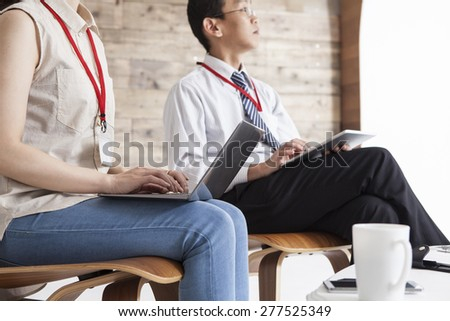 Business-team working on laptop and tablet at office - stock photo