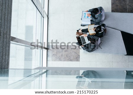 Business team working on report, view from the top - stock photo