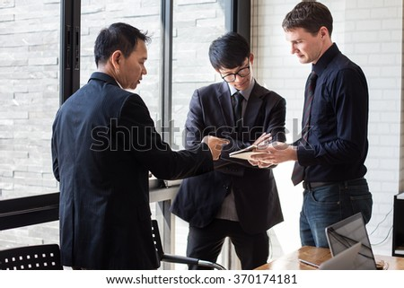 Business team working on their business project together at office. - stock photo