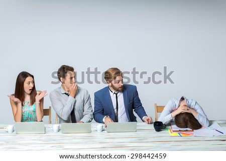 Business team working on their business project together at office on light gray background.  Everyone is wondering, boss sleeping. copyspace image.  - stock photo