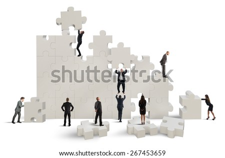 Business team working to build a puzzle