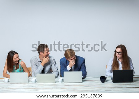 Business team working together at office on light gray background. all laughing. copyspace image - stock photo