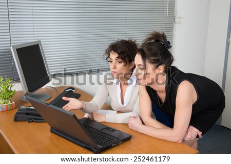 Business team working together in the office - stock photo