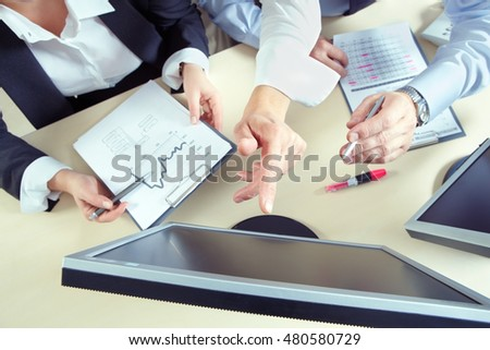 Business team working with computer presentation and finances