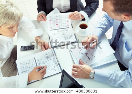 Business team working with finances at the table