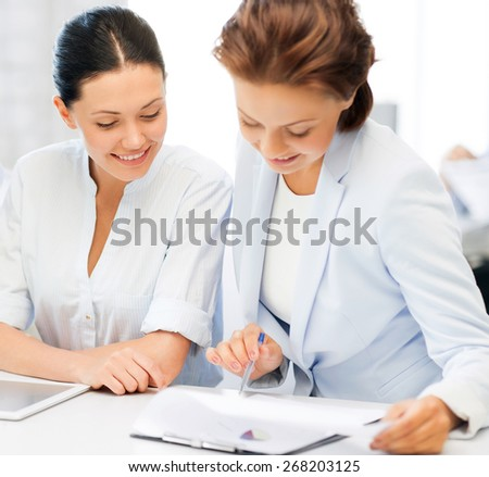 business team working with tablet pc and laptop in office