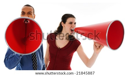 business team yelling in a red megaphone - stock photo