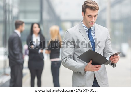Business Team, young businessman with folder. Selective focus - stock photo