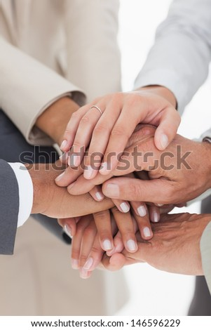 Business teams hands together in unity