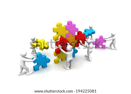 Business teamwork building puzzles together - stock photo