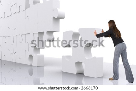 business teamwork - businesswoman building a puzzle which was made in 3d over a white background - stock photo