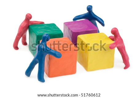 Business teamwork - collective problem solving. Plasticine. Isolated. - stock photo