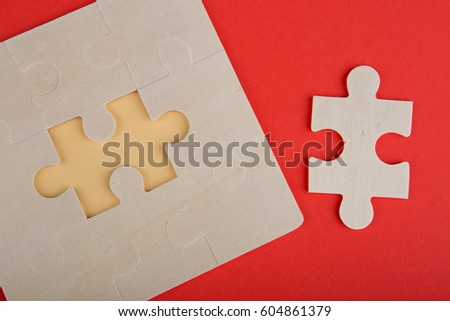 Business Teamwork Concept - Jigsaw Puzzle Pieces on red background