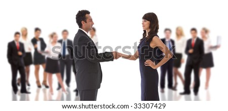business teamwork concept with a handshake and big team - stock photo